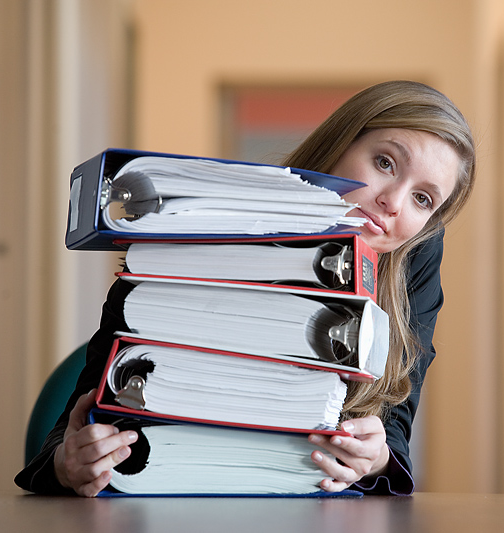 woman with a stack of law binders