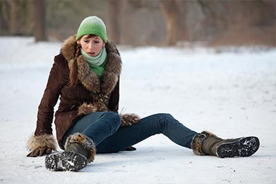 a fallen woman on the ice